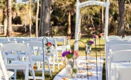Mason Jars Line the Aisle with Garden Chairs