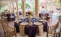 Purple and Gold Reception with Gold Chiavari Chairs