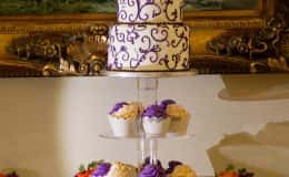 Purple and White Three Tier Wedding Cake with Cupcakes