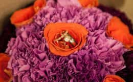 Wedding Rings on Bride's Purple Bouquet