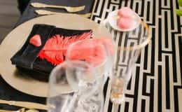 Sweetheart table place setting with velvet napkin and feather