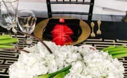 Sweetheart table place setting with black chiavari chair